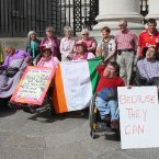 Disabled people and their carers hold a protest in Dublin today. They vow to stay overnight and continue their campaign until proposed cuts are reversed. Image: Niall Carson/PA Wire