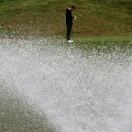 2010: Ian Poulter checks the yardage on Celtic Manor's 18th hole.