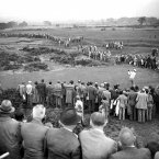 1949: Crowds stretch along the fairway to watch Johnny Palmer of the USA drive.