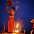 Indian Hindu priests performs evening rituals after taking a dip in the River Ganges, in Allahabad, India. (AP Photo/Rajesh Kumar Singh)