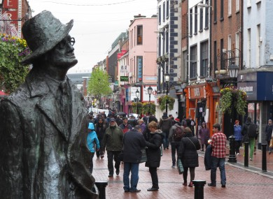 A statue of author James Joyce overlooks the scattered shoppers on Dublin's North Earl Street.