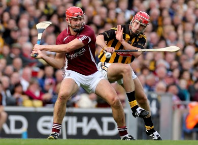 Galway's Joe Canning and Brian Hogan of Kilkenny battling in the drawn game.