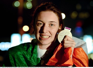 Ireland's Helen Kearney, from Dunlavin, Co. Wicklow, celebrates with her silver medal for individual championship test - grade 1a. 