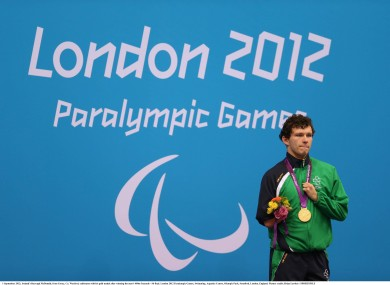 Darragh McDonald, from Gorey, Co. Wexford, celebrates with his gold medal after winning the men's 400m freestyle.