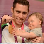 3 September 2012; Team Ireland's Jason Smyth, from Eglinton, Co. Derry, men's 100m - T13 gold medal winner, along with his 6 month old nephew Lewis D'hulst, at the team lodge. London 2012 Paralympic Games, Team Lodge, Stratford, London, England. Picture credit: Brian Lawless / SPORTSFILE