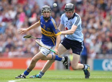 Tipperary's Mark McCarthy is chased by Dublin's Shane Barrett during the drawn game.