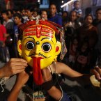 A masked artist prepares to perform a traditional dance on the first day of the week-long Indra Jatra festival in Katmandu, Nepal. (AP Photo/Niranjan Shrestha)