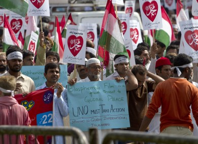 Supporters of Pakistani religious group Tehreek-e-Minhaj-ul-Qaran participate in a demonstration against the film yesterday