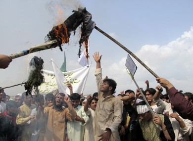 Afghans burn an effigy of U.S. President Barack Obama