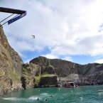A competitor during the first day of the Red Bull Cliff Diving World Series, at Blue Lagoon in Pembrokeshire, Wales.