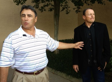 NFL head linesman Tom Stabile, left, and referee Ed Hochuli arrive at an Irving, Texas hotel to vote on an agreement between the two sides.