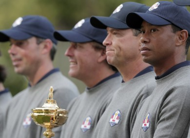 Tiger Woods, far right, and his US team-mates pose with the Ryder Cup for a picture.