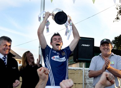 St. Galls' Sean Burke lifts the trophy.