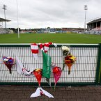 Flowers are laid pitchside at Ulster Rugby grounds.