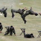 South Korean special army soldiers demonstrate their martial arts skills during the 64th anniversary of Armed Forces Day at the Gyeryong military headquarters in Gyeryong. (AP Photo/Lee Jin-man)