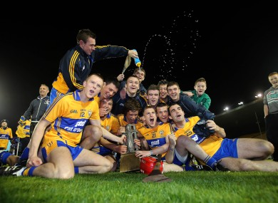 The Clare team celebrate with the trophy after the game.