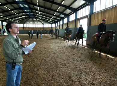 Aiden O'Brien instructs riders at Ballydoyle in 2008.