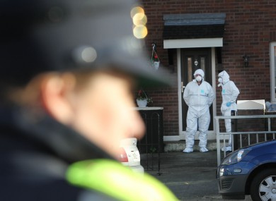 Gardaí and forensic examiners outside the house where John Wilson was shot dead last week.