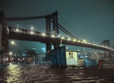 Streets are flooded under the Manhattan Bridge in the Dumbo section of Brooklyn, N.Y..