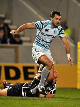 Niall Morris tries to break free against Sale Sharks.