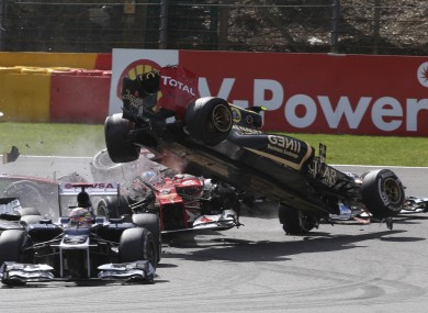 Romain Grosjean (right) in action for Lotus this season.