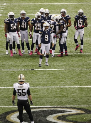 New Orleans Saints linebacker Barrett Ruud (55) waits for San Diego Chargers kicker Nick Novak (9) to kick off