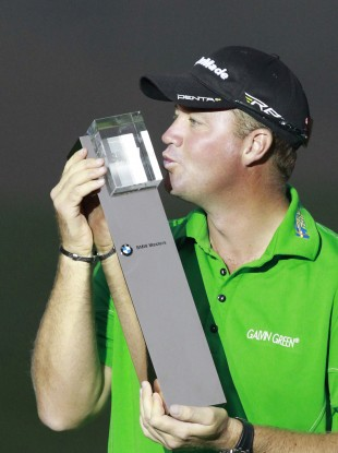 Peter Hanson from Sweden kisses his champion trophy during the award ceremony of the Masters golf tournament in Shanghai.