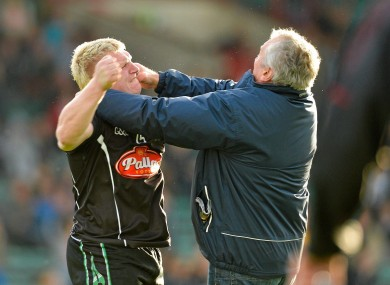 James Kelly, Newcastlewest, is confronted on the pitch by a supporter shortly after he was shown a second yellow card and subsequently a red card by referee Richard Moloney in yesterday's Limerick county final.