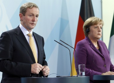 Enda Kenny and Angela Merkel speak to reporters after a meeting in Berlin last year. The two have issued a joint statement today acknowledging Ireland's financial situation is