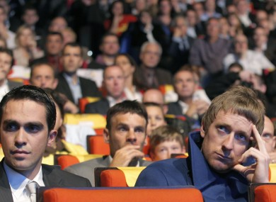 Alberto Contador of Spain, left, and Bradley Wiggins of Britain, attend the presentation of the hundredth edition of the Tour de France cycling race, in Paris today.