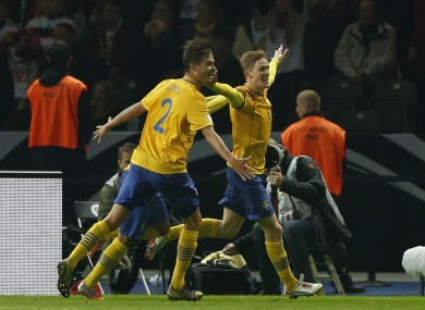 Rasmus Elm, right, celebrates the Swedish equaliser in Munich last month.