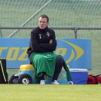 The injured Glenn Whelan sits out training.