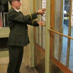 Assistant Station Master Cory Harris locks the main entrance to Grand Central Terminal, at 42nd Street and Park Avenue, after the last train departed at 7:10 p.m. last night. (Metropolitan Transportation Authority / Aaron Donovan)