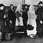 An undated photo of a group of immigrants arriving at Ellis Island. About 16 million people came through Ellis Island from 1892 to 1924. (AP Photo)