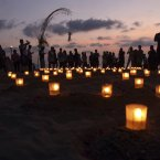 People gether light candle at a beach in remembrance of those killed as they mark the 10th anniversary of the Oct. 12, 2002 terrorist attacks at nightclubs in Kuta that killed 202 people, including 88 Australians and seven Americans in Kuta beach, Bali, Indonesia.(AP Photo/Firdia Lisnawati)