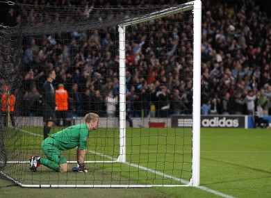 Hart kneeling in his goal as Balotelli takes a penalty down the other end. 