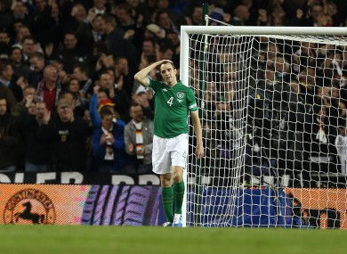 John O'Shea of Ireland dejected after Germany's 4th goal.