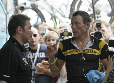 Lance Armstrong, right, talks to Johan Bruyneel in 2009 (file photo).