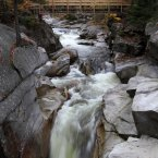 Leaves begin to turn peak colors at the The Middle Falls of the Ammonoosuc River in Crawford's Purchase, N.H. (AP Photo/Jim Cole)