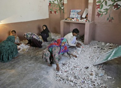 Hindus clean a temple after being attacked by a group of men in Karachi, Pakistan.