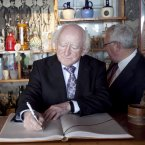 Michael D signing the visitors book at the Museum of Chilean poet Pablo Neruda, in Isla Negra, Chile where he also laid some wild flowers at the final resting place of Pablo and his wife Matilde Urrutia (Photo Chris Bellew/Fennell Photography)