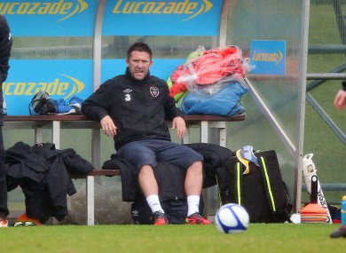 Ireland capatin Robbie Keane sits in the dugout during today's training session.