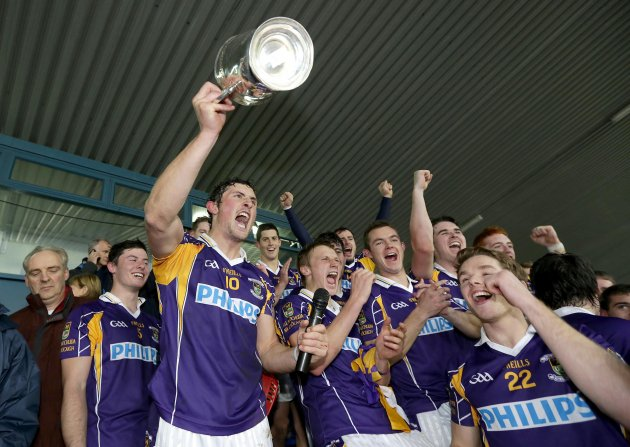 Ross O'Carroll raises the Senior Hurling Championship trophy 14/10/2012
