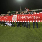 A banner is unveiled at the Showgrounds.