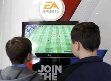 Young Everton fans enjoy a game on FIFA 13.