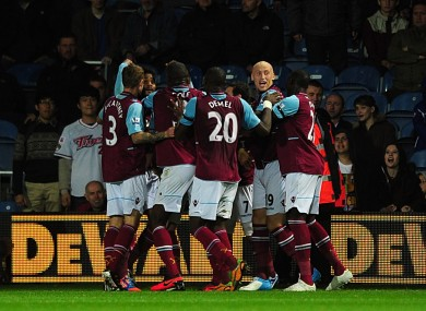 West Ham United's Ricardo Vaz Te (obscured) celebrates with team-mates after scoring his team's second goal.