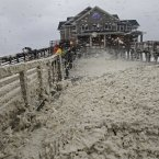 High winds blow sea foam onto Jeanette's Pier in Nags Head, North Carolina as wind and rain from Hurricane Sandy move into the area. (AP Photo/Gerry Broome)