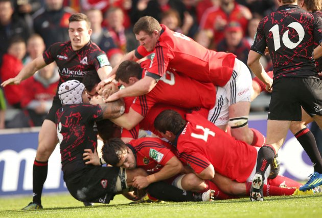 The Munster pack with Donnacha Ryan on top charge through on the Edinburgh pack 21/10/2012