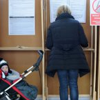 Childrens Rights Referendum Campaigns. Shirley Nugent casts her vote in the Children's Referendum in Rathmines in Dublin with her 10 month old son Ethan. Photo: Laura Hutton/Photocall Ireland