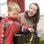 Tadhg O'Sullivan (aged 4) puts his mothers (Dervla O'Sullivan) ballot in the box in the Children's Referendum in Rathmines in Dublin. Photo: Laura Hutton/Photocall Ireland